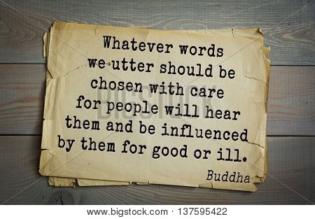 Buddha quote on old paper background. Whatever words we utter should be chosen with care for people will hear them and be influenced by them for good or ill.