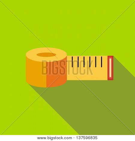 Yellow measuring tape icon in flat style on a green background