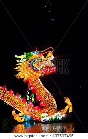 ROTTERDAM, NETHERLANDS, 02 FEB, 2014: Chinesse illuminated dragon on the lake in Rotterdam China Lights festival 2013