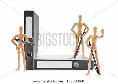 Three armed with pens wooden mannequins guarding office folders. Information security legal protection or bureaucratic barriers concept