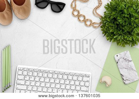 Top view scene with keyboard shoes phone plant over marble background. Styled stock photography. Digital product mockup.