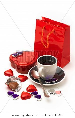 Valentine's Day composition with heart shape chocolate and coffee cup on white background