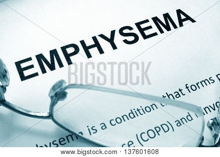 Paper with word  emphysema and glasses. Medical concept.