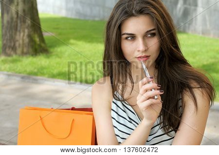 Woman Smokes Electronic Cigarette.
