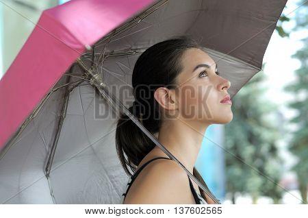 Woman Goes Under An Umbrella.