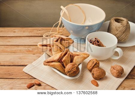 Hamantaschen cookies forJewish festival of Purim on wooden table
