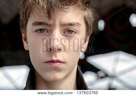 Close Up Portrait Of A Serious Teenage Boy