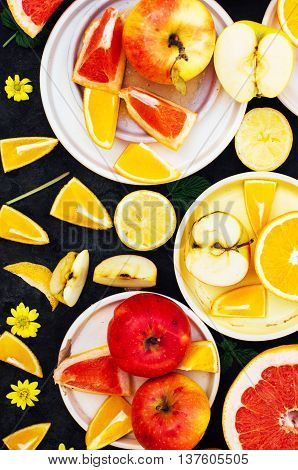 Mixed Festive Colorful Tropical And Citrus Fruit Sliced Over Bla
