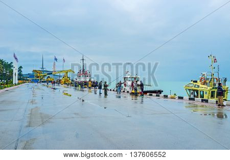 BATUMI GEORGIA - MAY 24 2016: The foggy evening after the hard rain is the nice time for the fishing in port on May 24 in Batumi.