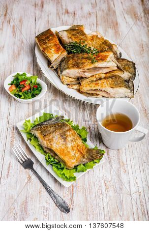 Fried Fish With Golden Crust On A White Plate