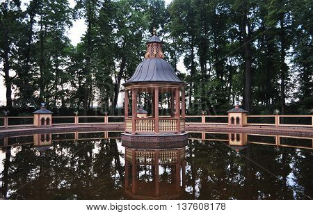 quiet summer evening in the gazebo on the lake