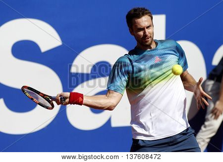 BARCELONA - APRIL,19: Latvian tennis player Ernests Gulbis in action during a match of Barcelona tennis tournament Conde de Godo on April 19, 2016 in Barcelona