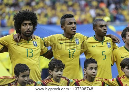 Belo Horizonte Brazil - july 08 2014: DANTE LUIZ GUSTAVO and FERNANDINHO of Brazil during the FIFA 2014 World Cup. Brazil is facing Germany in the semi-finals at Mineirao Stadium