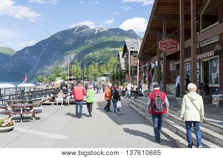 GERANGER, NORWAY - JUNE 29: Tourists enjoying the beautiful weather walking through the streets of Geiranger on June 29, 2016 in Geiranger, Norway. Geiranger is UNESCO heritage site.