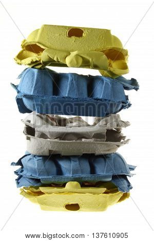Stack of Egg Cartons on White Background
