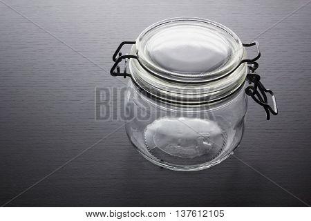 Empty Glass Jar on Warm Wooden Background