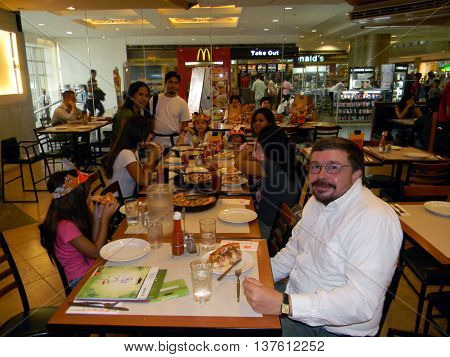 CEBU CITY, CEBU / PHILIPPINES - AUGUST 12, 2011: People eat pizza at the Pizza Hut in the SM City Cebu shopping mall.