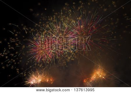 Colorful fireworks over dark sky.Fireworks light up the sky with dazzling display