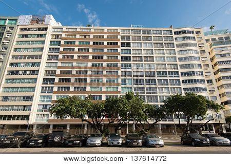 Rio de Janeiro, Brazil - July 7, 2016: Expensive apartment buildings in front of the Copacabana beach, along Avenida Atlantica avenue.