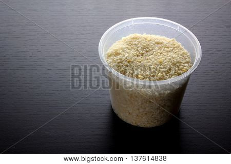 Jar of Bread Crumbs on Wooden Background