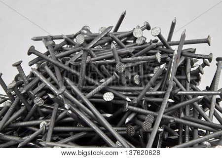 A pile of nails 60 mm. Nails are folded differently.