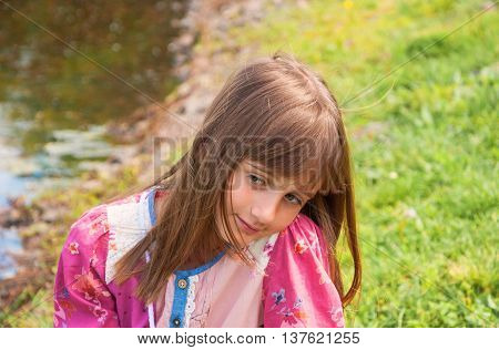 Portrait of a cute pensive romantic girl with gray eyes