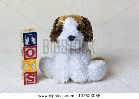 sweet stuffed dog with letters toy beige background