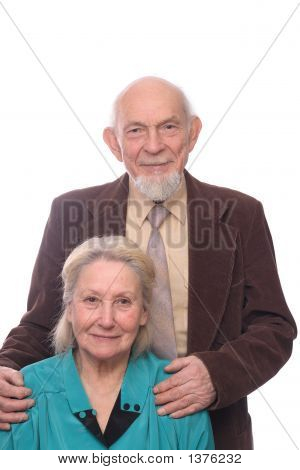 Senior Couple, Man Embracing Shoulders Of His Wife, Isolated On White Background