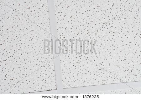 Surface Of White Perforated Ceiling Panel: Abstract Background