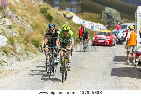 Col de la Croix de Fer France - 25 July 2015:Group of cyclists including Dan Martin of Cannondale-Garmin Team and Geraint Thomas of Team Sky climbing to the Col de la Croix de Fer in Alps during the stage 20 of Le Tour de France 2015.