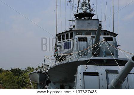 observation of old warship big gun blue sky