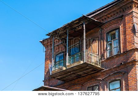 YEKATERINBURG RUSSIA-AUGUST 17 2013. Old balcony of apartment house of a merchant Chuvildin built in 1900. The house is an object of cultural heritage and regional value