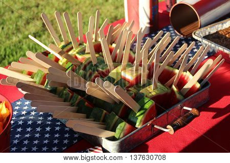 Watermelon pieces with wooden sticks for easy hold