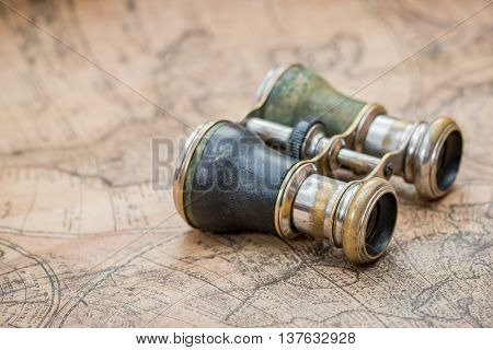 Pair of binoculars on an antique map