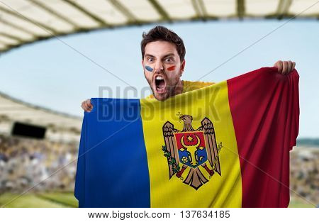 Fan holding the flag of Moldova