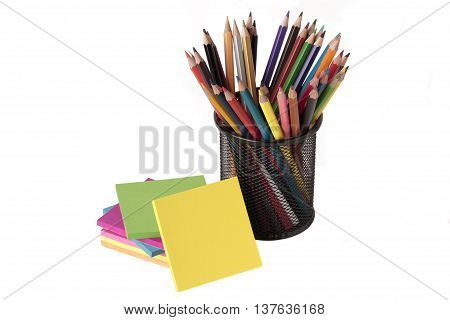 notes and colored pencils isolated on white background