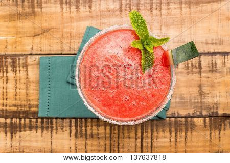 Watermelon juice with mint leaves on wooden vintage background