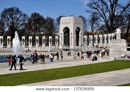 Washington DC - April 10 2014: The World War Two Memorial with the Atlantic Pavilion and steles engraved with the names of each of the 50 U. S. States