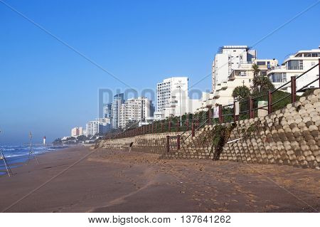 Early Morning Empty Beach And Concrete Retaining Wall