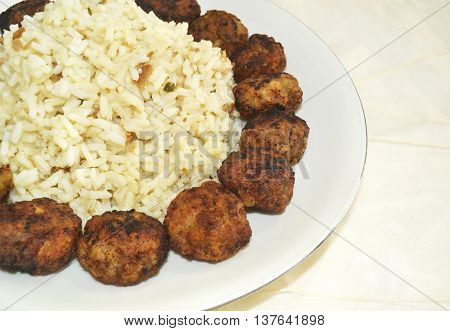 traditional greek rice pilaff with baked meatballs