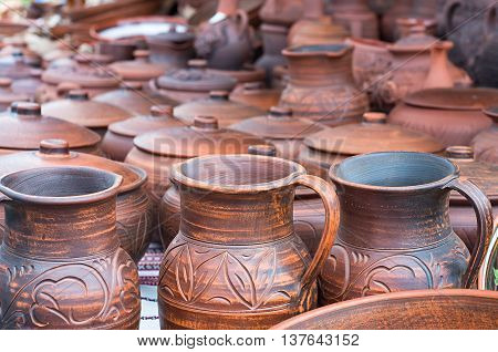 ancient clay pots with patterns on the market