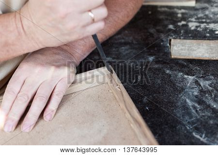 Carpenter Is Working With Chisel. Furniture.