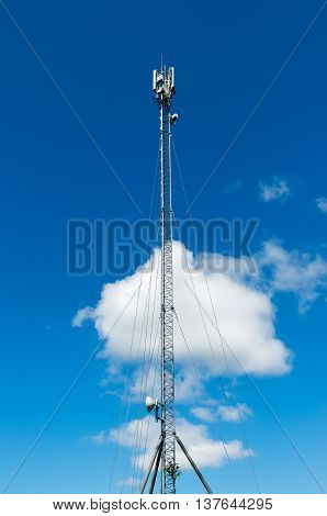 Telecommunication tower with antennas GSM mobile operator.