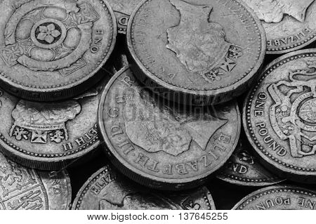 Black and white image of a lot of shiny pounds