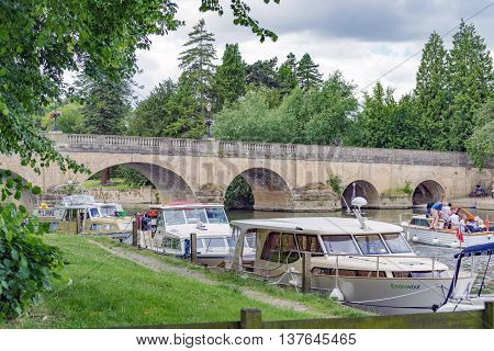 Wallingford/UK. 3rd July 2016. The River Thames at Wallingford with boats moored up by the bridge.