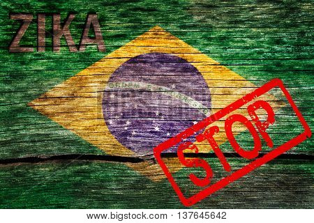 Brazil flag painted on the old cracked wood with word zika and alert warning before the virus infection
