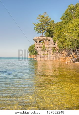 Chapel Rock a named formation in Pictured Rocks National Lakeshore' near Munising' Michigan. Mineral seepage creates the colors: Red and orange are iron, green and blue are copper, black is manganese and white is lime.