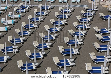 Deck Chairs at Sand Beach in South Italy