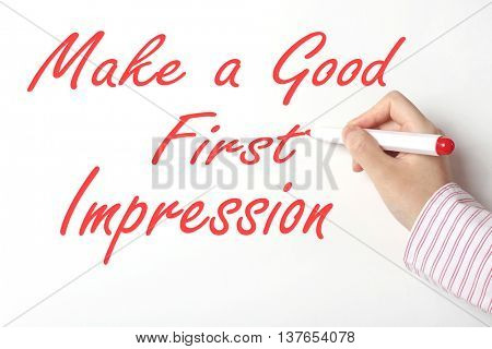 Business woman writing make a good first impression c word on whiteboard
