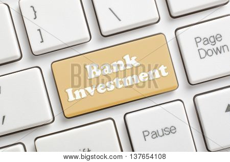 Brown bank investment key on keyboard